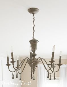 Easy DIY Vintage Chandelier Makeover With Paint And Wood Beads Painted Chandelier, Wood Bead Chandelier, Bottle Chandelier, Vintage Chandelier, Chandeliers, French Country Chandelier, Country Lamps, Country Living, Rope Pendant Light