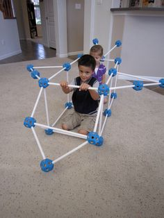 Buildeez: By inserting the precisely cut wooden dowels into the geometrically shaped Buildeez balls, kids are able to build life size objects and structures with little time and effort. Make an airplane, tank, tunnel, tent and more! #Toys #Building_Toys