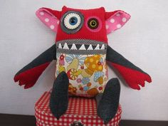 Meet 'Jane' Jane is a friendly girl monster softie and she's looking for a friend who won't care that she snorts when she laughs. She is approx 38cm (h) x 40cm (w) - claw to claw. She's made from used denim, felt and cotton and is filled with new polyester fibre fill.