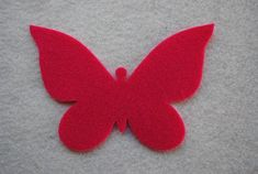 Listing includes 12 pieces total in 4 colors. You will receive 3 butterflies of each color. Measures approximately 4 3/4 across at the top and 3 tall. Colors included are: Red Shocking Pink Baby Pink White Cut in 100% polyester eco-fi craft felt, made from recycled plastic
