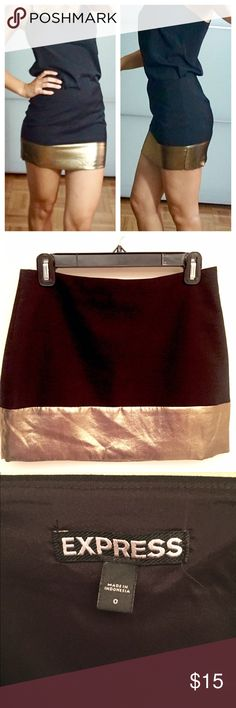 Gold & Black Miniskirt Black skirt with a gold metallic stripe around the bottom of the skirt. Size 0 but Express run a big large. I'm normally a 2-4. Express Skirts Mini