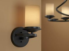 Wallbracket 1L. made of forge iron, oxide black finish. Decorated opal glass shade in cream-colored tonalities.