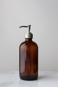 Our Amber Glass Apothecary Style Soap Dispenser adds sophisticated style to the bath or kitchen. Featuring amber glass and a durable metal pump, this