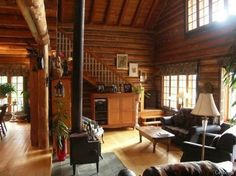 #wood #log #cabin cabins  not a fan of round logs - LOVE the stove placement