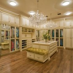 Now THAT'S a master closet. Be still my heart! (A girl can dream! ;)... Maybe turn spare room in to my dressing room