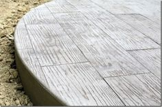 Want a wood-grain patio that doesn't need maintenance? Go for a wood-grain stamped concrete pattern! From The Lil' House That Could blog. More ideas for patio materials here: http://www.landscapingnetwork.com/patios/paving.html