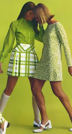 Circa 1971. Mini skirts and dresses in moss green, with sandals and knee-high socks.