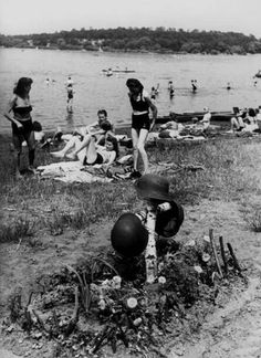 Germany. People bathing next to a soldiers' grave in the Havel River, Berlin 1945-1946