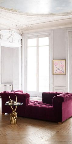 Burgundy tufted couch More
