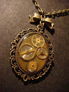$23.70 Victorian Style Steampunk Necklace -Gears and Watch Parts Set in Ice Resin with a Beautiful Bow