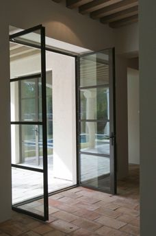 crittal style double doors also brick/terracotta floor Murphy Mears Architects | Lindenwood LEED® Residence