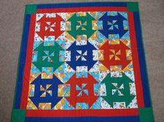 Circus Churn Dash Baby Quilt by TheScrappersBarrel on Etsy