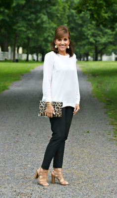 Looking for something new to wear to work this summer? Look no further than these awesome black pants, white shirt, and leopard print clutch. How's that for a fashion statement?