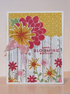 Love the look of the flowers stamped along the Hardwood fence!
