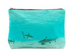 "A clutch featuring a beautiful but probably deadly scene. | 31 Must-Have Pieces For Your ""Shark Week"" Viewing Party"