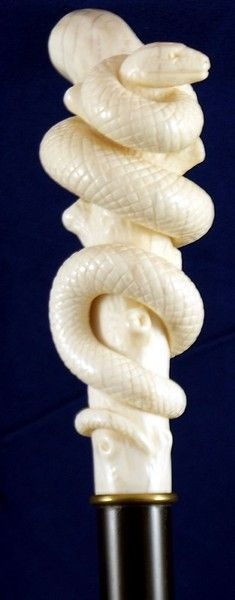 Carved ivory snake coiling around a branch hunting its prey, the mouse hiding in a hollow  of the tree. Mounted on a ebony shaft with a bone ferrule. Overall in excellent condition.  England, circa 1880 Overall Height of cane 39.50inch, 100cm