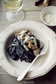 Black pasta with porcini mushrooms in a cream thyme sauce