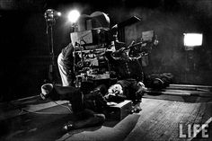"""W. Eugene Smith:  Director and actor Charles Chaplin laughing raucously, as he rolls around on floor gleefully during filming of """"Limelight.""""  1952.   © Time Inc."""