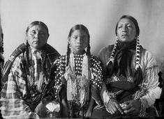 Walking Woman, her daughter Bear Woman, and her husband Scabby/1908
