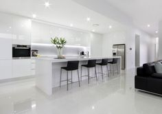 White Modern Kitchen With Island Bench And Stools, Integral Lighting, No  Handle Cupboards,