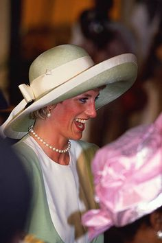 The Princess of Wales, wearing a green Catherine Walker suit and Philip Somerville hat, arrives in Lagos, Nigeria, for an official visit, March 1990.