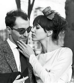 Anna Karina kissing Jean-Luc Godard. He is smilling! Beautiful.