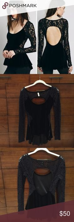 Free People Black Lolita Velvet Peplum Top Velvet peplum high low blouse with contrast lace sleeves and sides. Open back and a low scoop neck. In perfect condition and never been worn. Free People Tops Tees - Long Sleeve