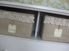 Burlap covered storage box.  Just covered diaper boxes and added a ruffle.