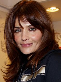 Helena Christensen ~ The model rocks precisely cut layers that are flipped out at the ends, giving the look shape and volume. Bangs add a soft element to the look. ~