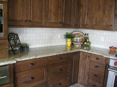 dark stained knotty alder with granite | Venecian Gold granite - What cabinate colors would match ? - Kitchens ...