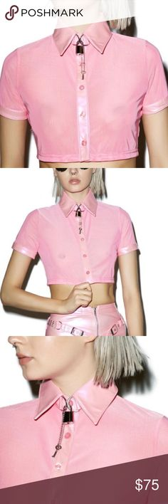 Better Locked Up Collared Shirt. Price firm. Dolls Kill 24HRS Better Locked Up Than Knocked Up Collared Shirt.  short sleeve cropped top constructed from sexy pink sheer mesh with pretty iridescent vegan leather trim featuring a functional lock 'N key collar neckline and front button closure.   Materials: 92% Polyester, 8% Spandex Hand Wash Cold Lock and key included Our Doll wears XS and is 5'10 Tops Crop Tops
