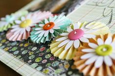 I can easily make these flowers with the paper and buttons in my stash. (stash-buster).