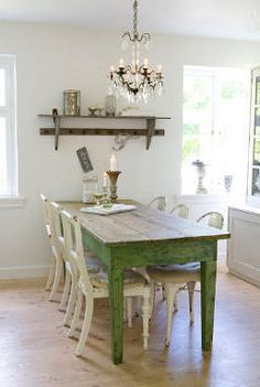 Farmhouse table..these colors go even better with MY kitchen. But I don't want a chandelier, I want ceiling fans and lights. (We have no a/c..YET!)