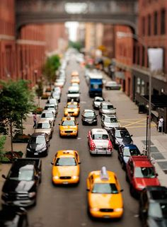 Special effects (tilt shift lens) of busy street scene makes it seem like miniatures in motion.