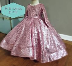 The current turnaround time can be found in our shop announcements. DESCRIPTION Dazzle the crowds at your special event with a handmade original dress design by Alora Safari. This gown features thousands of sequins, open back design, and lots of tulle for volume. Perfect for any special