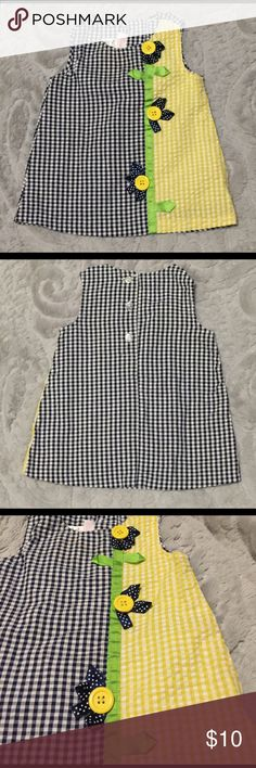 "Bonnie Baby split color plaid dress Cute and lightweight Bonnie Baby split color plaid dress. Ribbons turned into flowers and centered with buttons. Additional thin Polyester/cotton lining to eliminate any ""see through"" issues. Seriously ladies, this dress is C-U-T-E! Bonnie Baby Dresses"