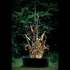 Canadian artist Douglas Walker collects discarded musical instruments, brass, copper and plumbing parts and transforms them into magical garden features.