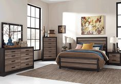 <strong>Harlinton Queen Set </strong>With its unique two-tone treatment of replicated oak grain, Harlinton queen set is where modern meets vintage in the coolest possible way. Beautifully weathered treatment of the inlaid plank-style boards has a very reclaimed quality, while the darker, contrasting framework and ultra clean-lined design is urban chic.<em>*The Harlington queen set consists of a queen bed, dresser, mirror and night stand. The chest shown in the image is not included.</em>