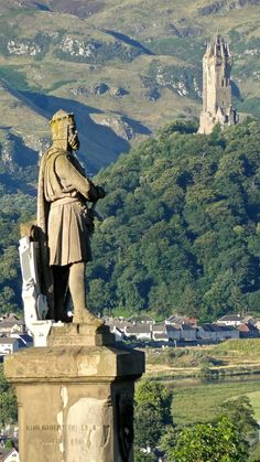 The Robert de Brus statue at Stirling Castle with the William Wallace monument on Abbey Craig in the background. Stirling, Scotland. 1989.