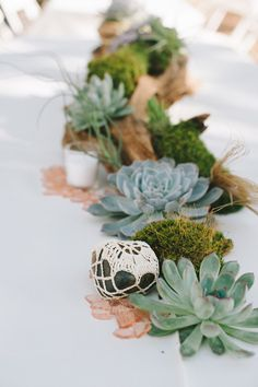 wrap rocks in doilies + lace - photo by Nathan Russell Photography http://ruffledblog.com/round-mountain-texas-wedding #weddingideas #centerpieces #diy