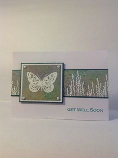 handcrafted greeting card ... emboss resist ... Distress Ink on glossy card stock then sprayed with Perfect Pearls ... like the card design ... focal point layered panel on a wide band in the same colors ... butterfly and meadow grasses ... lovely card ...