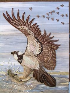 Eagle is hunting (marquetry and inlay carving)