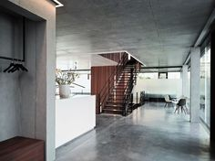 //\\ the concrete on the seat to the left //\\ the linear light flush set in the concrete ceiling around the stairs.