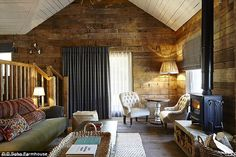 Country perfection: Inside one of the cabins at the Farmhouse, which cost up to £750 a nig...