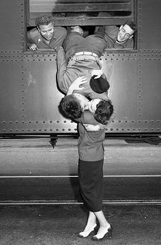 Sept. 6, 1950: Pvt. Robert Maye and his wife, Gloria, kiss goodbye with the help of Harvey Wilson, left, and Frank Harvey. The couple have been married 18 months and have a 6-month-old daughter.