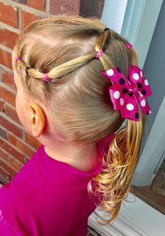 Day 28 style: fun elastic style for a Water Play Day in Nursery class; connected side ponies with top split pony joined into a ponytail