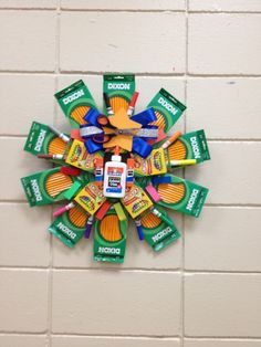 School Supply Wreath (great gift) - I would sure make some of these back-to-school wreaths for any teacher who would like one. So many to choose from.
