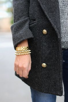 Warm coat and bracelets, different shades of gray with light jeans