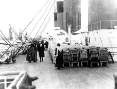People walk on the deck of the Titanic. (Denver Post Archives) #