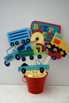 Transportation themed centerpiece, cars and trucks birthday centerpiece Cars Trucks Birthday Party, Truck Birthday Cakes, Transportation Birthday, Race Car Birthday, Boy Birthday Parties, 2nd Birthday, Birthday Ideas, Car Centerpieces, Birthday Centerpieces